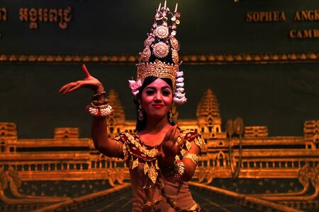 SIEMREAP, KHMER REPUBLIC - FEBRUARY 11: The unidentified woman is performing in Khmer dance in between a dinner meeting on February 11, 2012 at Sophea Angkor Pich Restaurant, Siemreap, Khmer Republic.