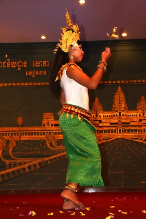 indo china: SIEMREAP, KHMER REPUBLIC - FEBRUARY 11: The unidentified woman is performing in Khmer dance in between a dinner meeting on February 11, 2012 at Sophea Angkor Pich Restaurant, Siemreap, Khmer Republic.