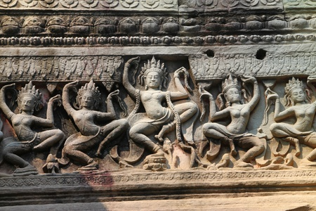 Carvings Apsara on wall in ancient Khmer architecture, Prasat Praeh Khan photo