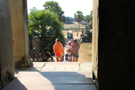 handscraft: SIEMREAP, KHMER REPUBLIC - FEBRUARY 11 : The unidentified tourists are visiting ancient architecture on February 11, 2012 at Angkor Wat, Siemreap, Khmer Republic.