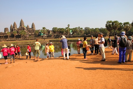 SIEMREAP, KHMER REPUBLIC - FEBRUARY 11 : The unidentified tourists are traveling to ancient architecture on February 11, 2012 at Angkor Wat, Siemreap, Khmer Republic.