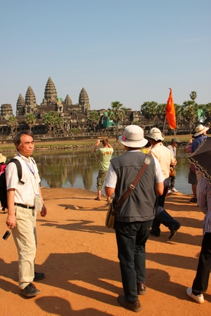 handscraft: SIEMREAP, KHMER REPUBLIC - FEBRUARY 11 : The unidentified tourists are traveling to ancient architecture on February 11, 2012 at Angkor Wat, Siemreap, Khmer Republic. Editorial