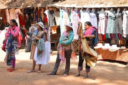 SIEMREAP, KHMER REPUBLIC - FEBRUARY 11 : The unidentified Khmer women are selling clothes on February 11, 2012 at Angkor Thom, Siemreap, Khmer Republic. Stock Photo - 12272722