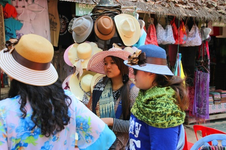 handscraft: SIEMREAP, KHMER REPUBLIC - FEBRUARY 11 : The unidentified women are buying hats on February 11, 2012 at Angkor Thom, Siemreap, Khmer Republic.