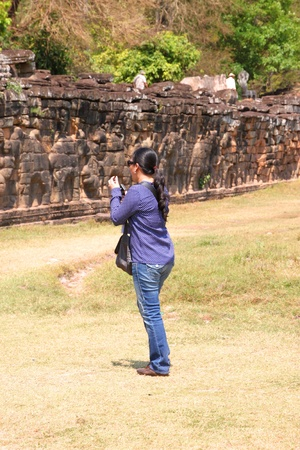 SIEMREAP, KHMER REPUBLIC - FEBRUARY 11 : The unidentified tourist is taking photograph on February 11, 2012 at Terrace of the elephants, Angkor Thom, Siemreap, Khmer Republic.