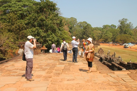 SIEMREAP, KHMER REPUBLIC - FEBRUARY 11 : The unidentified tourists are visiting Terrace of the elephants on February 11, 2012 at Angkor Thom, Siemreap, Khmer Republic.