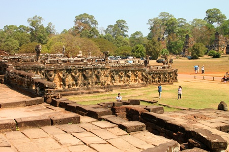 handscraft: SIEMREAP, KHMER REPUBLIC - FEBRUARY 11 : The unidentified tourists are visiting Terrace of the elephants on February 11, 2012 at Angkor Thom, Siemreap, Khmer Republic. Editorial
