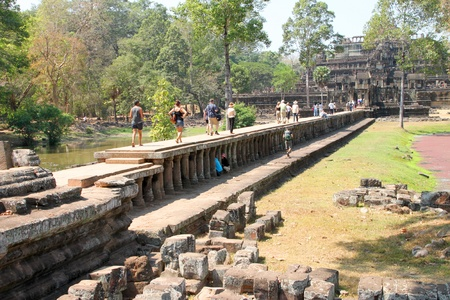 handscraft: SIEMREAP, KHMER REPUBLIC - FEBRUARY 11 : The unidentified tourists are traveling and visiting ancient architecture on February 11, 2012 at Angkor Thom, Siemreap, Khmer Republic.