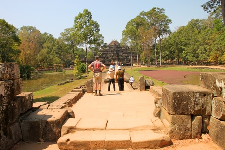 SIEMREAP, KHMER REPUBLIC - FEBRUARY 11 : The unidentified tourists are traveling and visiting ancient architecture on February 11, 2012 at Angkor Thom, Siemreap, Khmer Republic. Stock Photo - 12272721