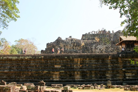 handscraft: SIEMREAP, KHMER REPUBLIC - FEBRUARY 11 : The unidentified tourists are visiting Reclining Buddha in ancient architecture on February 11, 2012 at Angkor Thom, Siemreap, Khmer Republic.
