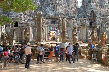 SIEMREAP, KHMER REPUBLIC - FEBRUARY 11 : The unidentified tourists are traveling and visiting Prasat Bayon on February 11, 2012 at Angkor Thom, Siemreap, Khmer Republic. Stock Photo - 12272729