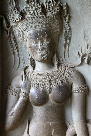 handscraft: Apsara carving on wall of Angkor Wat, Siemreap, Khmer Republic