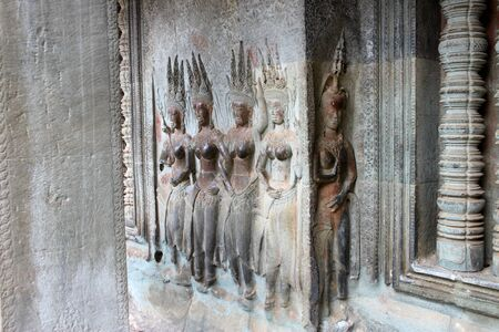 Apsara carving on wall of Angkor Wat, Siemreap, Khmer Republic photo
