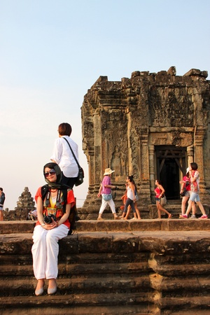 indo china: SIEMREAP, KHMER REPUBLIC - FEBRUARY 11 : The unidentified tourists are traveling to see sunset on February 11, 2012 at Phnom Bakheng mountain, Siemreap, Khmer Republic. Editorial