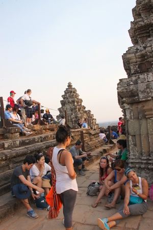 indo china: SIEMREAP, KHMER REPUBLIC - FEBRUARY 11 : The unidentified tourists are waiting to see sunset on February 11, 2012 at Phnom Bakheng mountain, Siemreap, Khmer Republic.