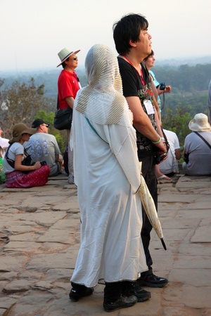 SIEMREAP, KHMER REPUBLIC - FEBRUARY 11 : The unidentified tourists are waiting to see sunset on February 11, 2012 at Phnom Bakheng mountain, Siemreap, Khmer Republic. Stock Photo - 12385577