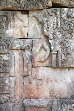 handscraft: Stone carving on wall in palace of Angkor Thom, Siemreap