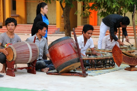 SIEMREAP, KHMER REPUBLIC - FEBRUARY 10 : The unidentified orphan and vulnerable children are in traditional music class on February 10, 2012 at Salvation Center Cambodian, Wat Tep Pothivong (Wat Thmey), Siemreap, Khmer Republic.