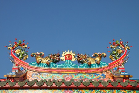 Golden dragons on roof of Chinese shrine photo