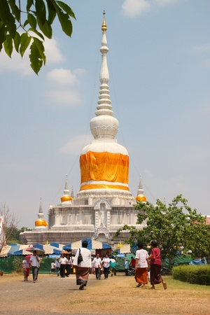 mahasarakham: NA DUN, MAHASARAKHAM, THAILAND - MARCH 7 : The unidentified Buddhists are doing religious merit activities in Magha Puja Day on March 7, 2012 at Na Dun Pagoda, Mahasarakham, Thailand.