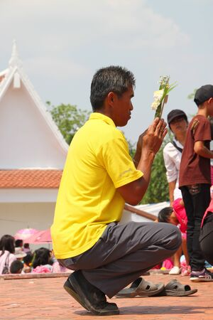 puja: NA DUN, MAHASARAKHAM, THAILAND - MARCH 7 : The unidentified Buddhists are doing religious merit activities in Magha Puja Day on March 7, 2012 at Na Dun Pagoda, Mahasarakham, Thailand.