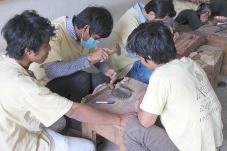 handscraft: SIEMREAP, KHMER REPUBLIC - FEBRUARY 12 : The unidentified men are working in handicraft center on February 12, 2012 at Siemreap, Khmer Republic.