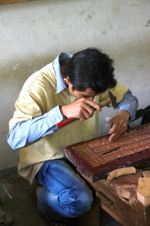 handscraft: SIEMREAP, KHMER REPUBLIC - FEBRUARY 12 : The unidentified man is working in handicraft center on February 12, 2012 at Siemreap, Khmer Republic.