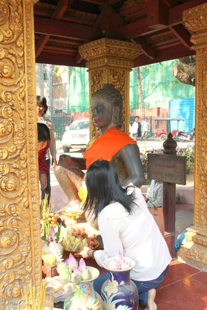 indo china: SIEMREAP, KHMER REPUBLIC - FEBRUARY 12 : The unidentified tourists are doing religious merit on February 12, 2012 at City Pillar, Siemreap, Khmer Republic.