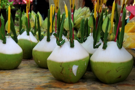 indo china: Young coconut, candle and joss stick for Buddha offering Stock Photo