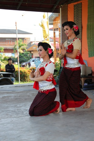 BORABUE, MAHASARAKHAM, THAILAND - FEBRUARY 9 : The unidentified women are performing Thai dance in grand opening OTOP market on February 9, 2012 at Borabue city hall plaza, Mahasarakham, Thailand.