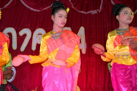 semester: PAYAKKAPHUMPHISAI, MAHASARAKHAM, THAILAND - MARCH 11 : The unidentified children are performing local dance in the end of semester Iam Suk school party on March 11, 2012 at city hall plaza, Payakkaphumphisai, Mahasarakham, Thailand.