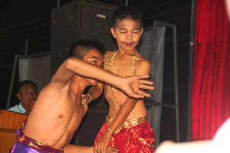 PAYAKKAPHUMPHISAI, MAHASARAKHAM, THAILAND - MARCH 11 : The unidentified children are performing Phra Apai Manee folk story in the end of semester Iam Suk school party on March 11, 2012 at city hall plaza, Payakkaphumphisai, Mahasarakham, Thailand. Stock Photo - 12591709