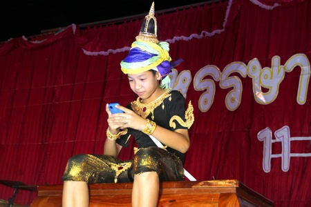 PAYAKKAPHUMPHISAI, MAHASARAKHAM, THAILAND - MARCH 11 : The unidentified pupil is performing Phra Apai Manee folk story in the end of semester Iam Suk school party on March 11, 2012 at city hall plaza, Payakkaphumphisai, Mahasarakham, Thailand. Stock Photo - 12591695