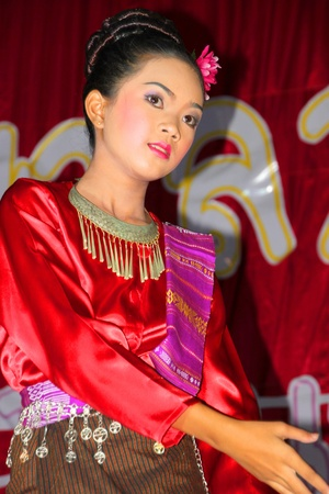 semester: PAYAKKAPHUMPHISAI, MAHASARAKHAM, THAILAND - MARCH 11 : The unidentified girl is performing Pong Lang dance and music in the end of semester Iam Suk school party on March 11, 2012 at city hall plaza, Payakkaphumphisai, Mahasarakham, Thailand.