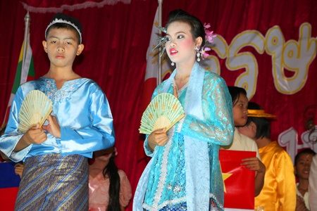 PAYAKKAPHUMPHISAI, MAHASARAKHAM, THAILAND - MARCH 11 : The unidentified children are performing The Spirit of Asian in the end of semester Iam Suk school party on March 11, 2012 at city hall plaza, Payakkaphumphisai, Mahasarakham, Thailand.