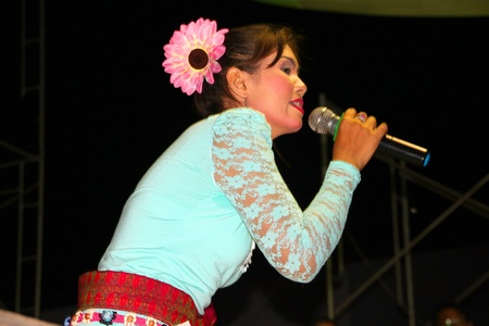 NACHAUK, MAHASARAKHAM, THAILAND - MARCH 17 : The unidentified woman is singing in song contest on March 17, 2012 at city hall plaza, Nachauk, Mahasarakham, Thailand. Stock Photo - 12690843