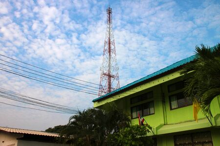 Very high antenna pole tower and blue sky photo