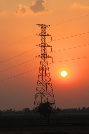 Very high voltage pole tower and sky at sunset