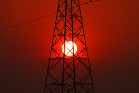 Very high voltage pole tower and sky at sunset photo
