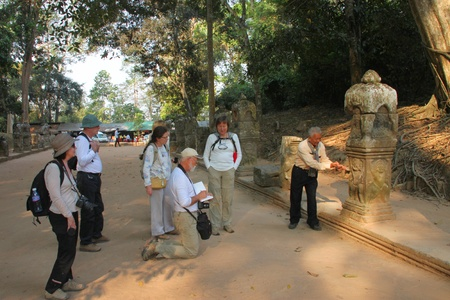 indo china: SIEMREAP, KHMER REPUBLIC - FEBRUARY 11 : The unidentified tourists are listening to Khmer local guide on February 11, 2012 at Prasat Preah Khan, Siemreap, Khmer Republic.