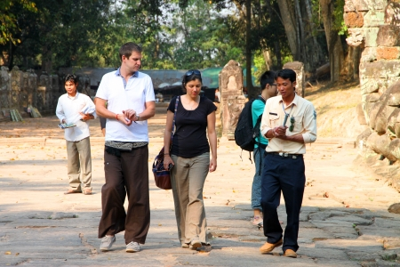 indo: SIEMREAP, KHMER REPUBLIC - FEBRUARY 11 : The unidentified tourists are listening to Khmer local guide on February 11, 2012 at Prasat Preah Khan, Siemreap, Khmer Republic.