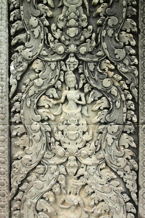 handscraft: Carvings on wall and terrace of Angkor Wat, Siemreap, Khmer Republic. Stock Photo