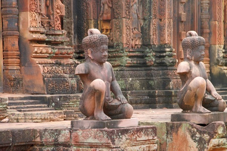 Pink stone guardian statue carvings of Banteay Srei, Siemreap, Khmer Republic. photo