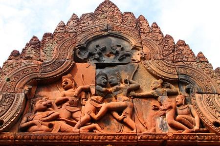 Pink stone monkeys fighting carvings of Banteay Srei, Siemreap, Khmer Republic. photo