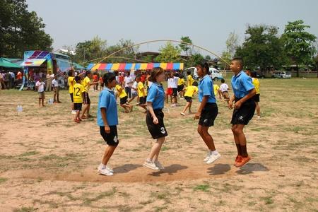 NACHUAK, MAHASARAKHAM, THAILAND - MARCH 21 : The unidentified children are skipping rope on March 21, 2012 at Nong Bua Daeng School playground, Nachuak, Mahasarakham, Thailand. Stock Photo - 13155001