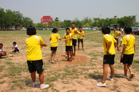 NACHUAK, MAHASARAKHAM, THAILAND - MARCH 21 : The unidentified children are skipping rope on March 21, 2012 at Nong Bua Daeng School playground, Nachuak, Mahasarakham, Thailand. Editorial