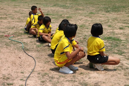 NACHUAK, MAHASARAKHAM, THAILAND - MARCH 21 : The unidentified children are waiting for skipping rope on March 21, 2012 at Nong Bua Daeng School playground, Nachuak, Mahasarakham, Thailand.