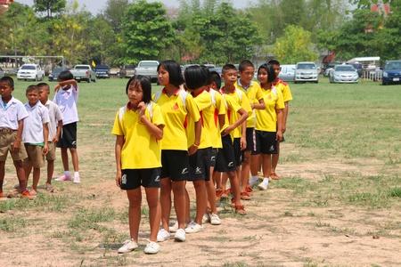 NACHUAK, MAHASARAKHAM, THAILAND - MARCH 21 : The unidentified children are working out on March 21, 2012 at Nong Bua Daeng School playground, Nachuak, Mahasarakham, Thailand.