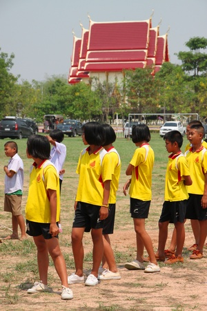 NACHUAK, MAHASARAKHAM, THAILAND - MARCH 21 : The unidentified children are working out on March 21, 2012 at Nong Bua Daeng School playground, Nachuak, Mahasarakham, Thailand. Stock Photo - 13154979