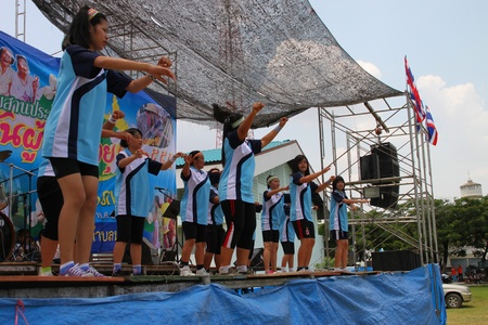 NACHUAK, MAHASARAKHAM, THAILAND - APRIL 13 : The unidentified women are performing aerobic dance in Songkran Day on April 13, 2012 at district hall plaza, Nachuak, Mahasarakham, Thailand.